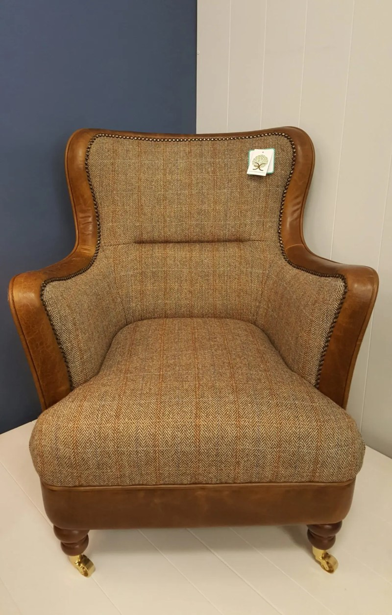 Vintage Sofa Co Ellis FT Chair low slung armchair in hunting lodge harris tweed and cerato leather edging on brass castors