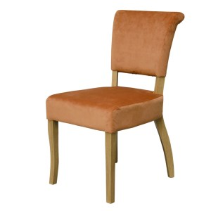 Capri velvet dining chair in burnt orange and oak legs