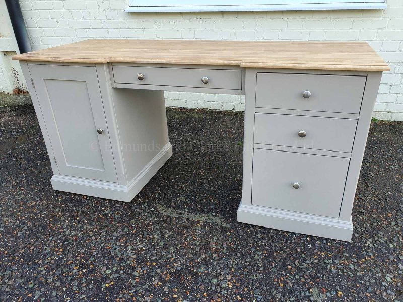 Painted double pedestal desk with oak top, cupboard on left side drawers on right, small drawer above kneehole