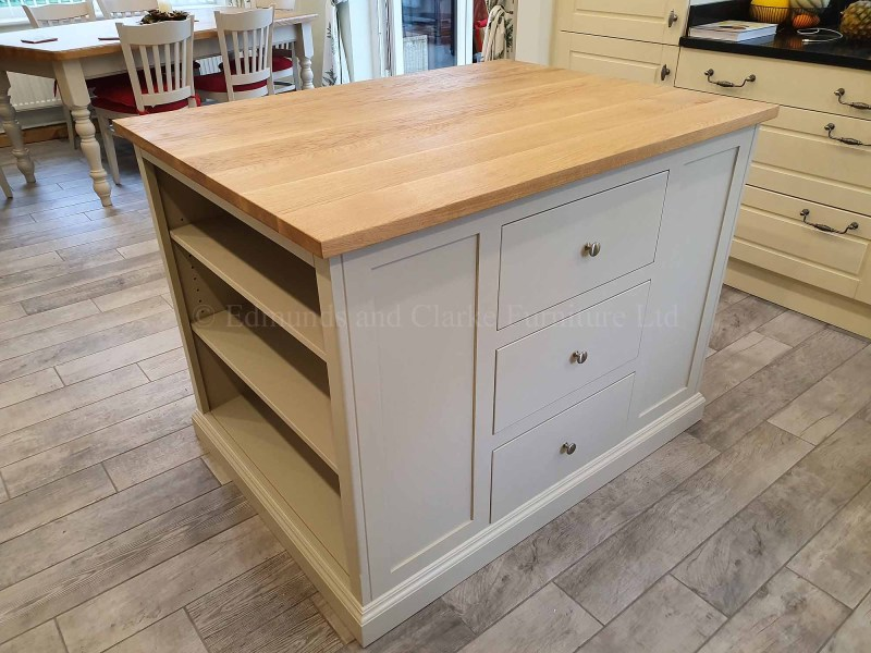 Kitchen Island painted grey with oak top, shelving both ends and central bank of drawers