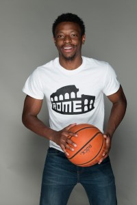 Student wearing a Rome white t-shirt and holding a basket ball