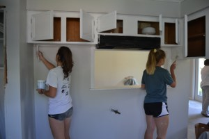More tennis players painting walls