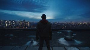 Young Shazam staring off of the top of a building