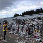 Person looking at piles of trash