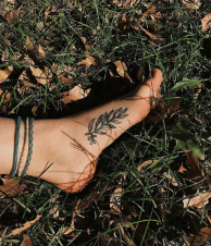 Bridgette Ross's foot tattoo on grass
