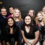 Graphic design students at a professional photo booth at the Addy's