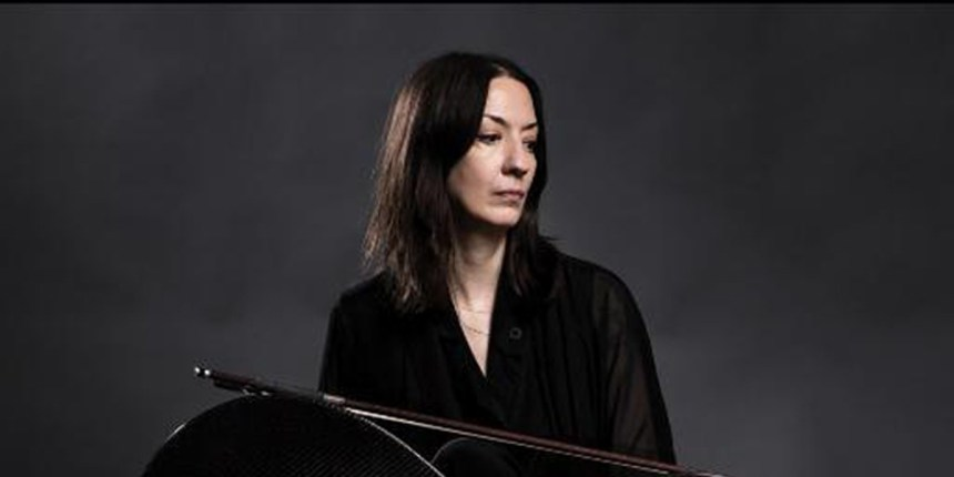 Julia Kent with cello sideways