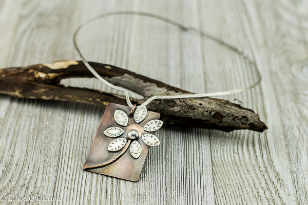 image of rectangular mixed metal flower pendant on sterling silver neck wire