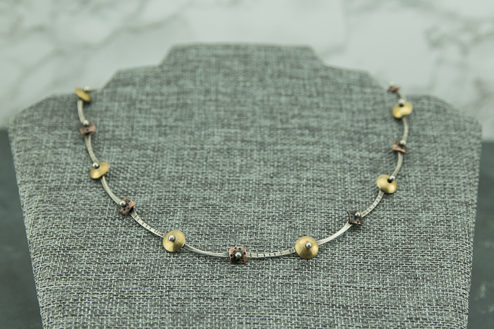 Mixed metal patina copper, brass and sterling silver necklace, ball riveted with round and square connectors.