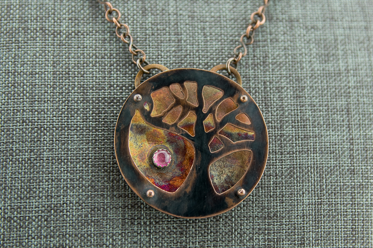 Layered patina copper tree of life pendant with pink tourmaline
