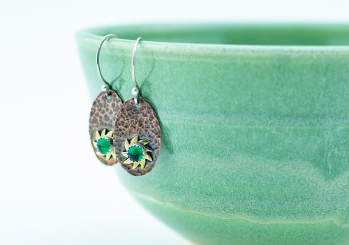 Hammered copper earrings with sunburst and green glass cabochons