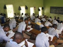 Students writing exam 638x424 1 - Politics