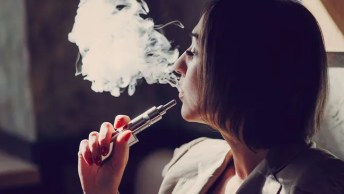 Business woman vaping