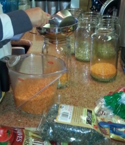 A wide-mouthed funnel makes filling the jars a great project for the kids.