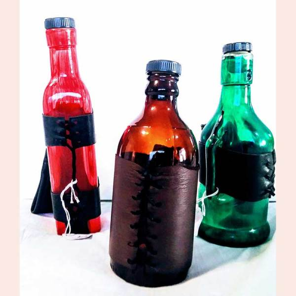 Leather bottle cozies and carriers by Adventurer's Emporium