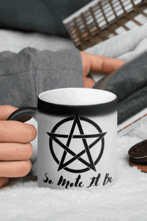 This so mote it be coffee mug changes colors when it gets hot, and features a beautiful witch's pentacle for spiritual protection. The perfect design for a witch that is obsessed with coffee. Practice black magick while drinking black coffee! #witchcraft #pentagram #coffee #witch