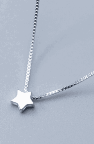 Sterling Silver Cosmic Star Necklace: The perfect necklace for any star child and star seed. Give off wonderful space energy with this delicate silver choker necklace. Star symbolism has existed throughout time and in all cultures. There is a rich history to pull from to understand the meaning behind stars when worn or seen. Stars can symbolize aspiration, inspiration, imagination, excellence, wonder, dreams, protection, magic, creativity, divine guidance, and fate.