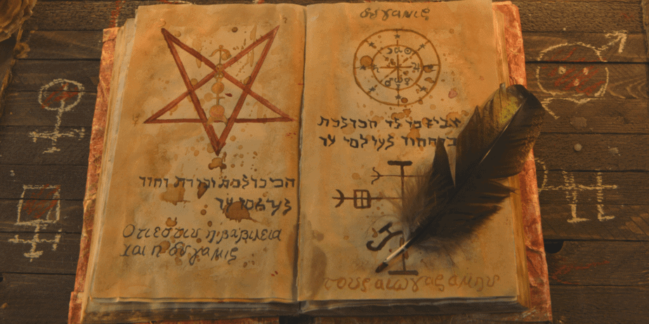 A feather upon a witch's book of shadows with hebrew letters and a pentagram on top of a wooden table with occult symbols scratched into it.