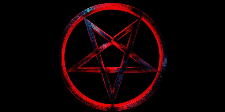 A red and blue reversed pentagram on a black background