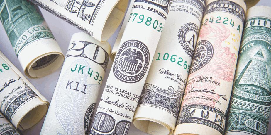 Rolled 20 dollar bills to represent prosperity