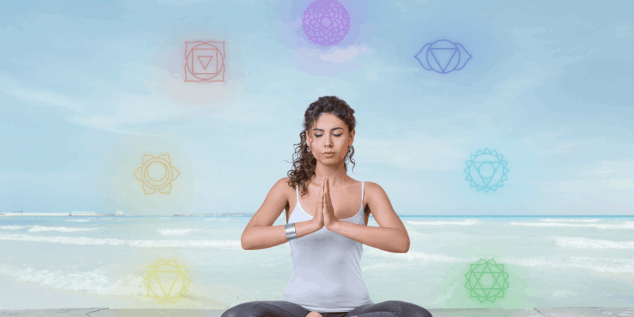 A woman meditating to heal her chakras