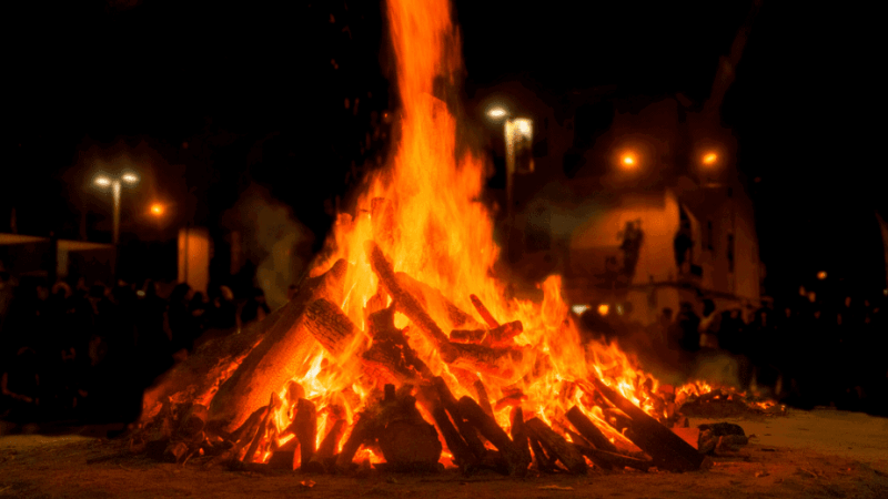 Decorative image of a huge Litha bonfire