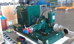 Pump Inlet and Outlet – This picture is of the diesel motor that powers the system. The pump itself is the big disc shaped thing to the left of the big cylinder sticking up with a hose coming out of it.