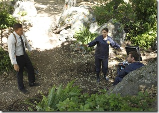 """BONES:  Brennan (Emily Deschanel, C), Booth (David Boreanaz, L) and Hodgins (TJ Thyne, R) investigate remains found in a paintball field in """"The Memories in the Shallow Grave"""" season seven premiere of BONES airing Thursday, Nov. 3 (9:00-10:00 ET/PT) on FOX.  ©2011 Fox Broadcasting Co. Cr:  Beth Dubber/FOX"""