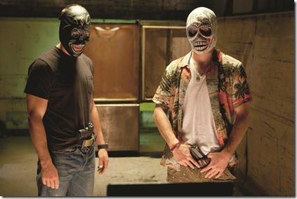 "(L to R) Chon (TAYLOR KITSCH) and his closest friend, Ben (AARON JOHNSON), ready for war in ""Savages"", the ferocious thriller from three-time Oscar®-winning filmmaker Oliver Stone that features the all-star ensemble cast of Kitsch, Blake Lively, Johnson, John Travolta, Benicio Del Toro, Salma Hayek, Emile Hirsch and Demián Bichir."