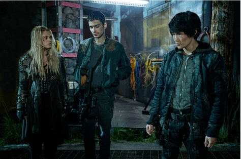 Pictured (L-R): Eliza Taylor as Clarke, Devon Bostick as Jasper, and Chris Larkin as Monty -- Credit: Diyah Pera/The CW -- © 2016 The CW Network, LLC.