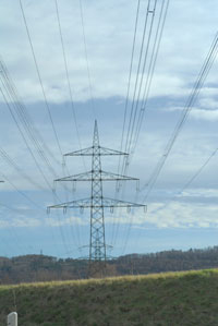 Oil - Electricity is sent to our homes through transmission lines