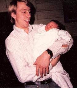 John Heissenbuttel holding Jessie Leigh Heissenbuttel, born March 20, 1986