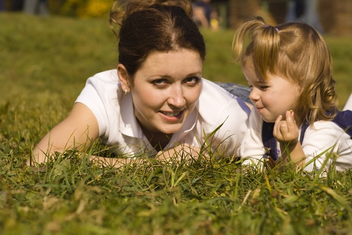 Mother and child playing in grass