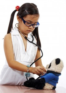 Girl Playing At Being A Doctor