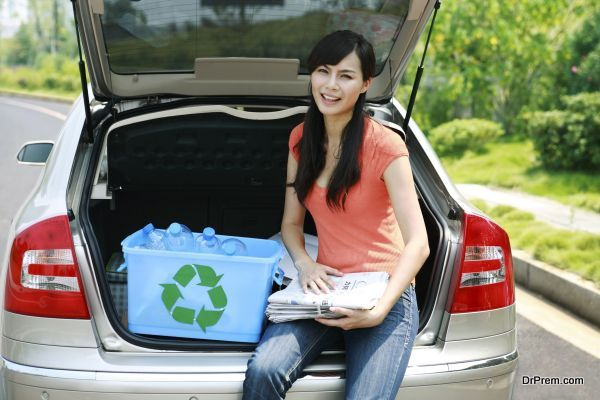 a woman sitting in the trunk
