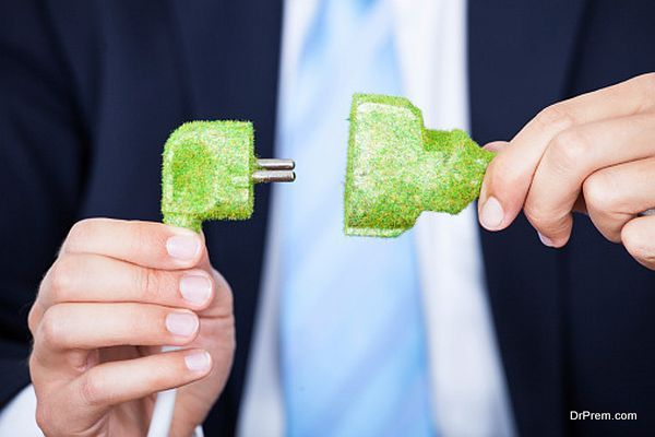 Businessman Holding Grass Covered Cable
