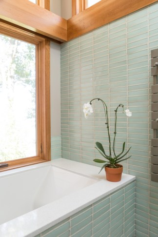 Coke Bottle Clear recycled glass tiles offer a fresh, spa-like aesthetic to your home.
