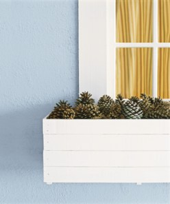 When autumn comes and the temperature dips, outdoor decorating becomes more challenging. Collect pinecones and pile them in an empty flower box for a pretty, no-maintenance display.