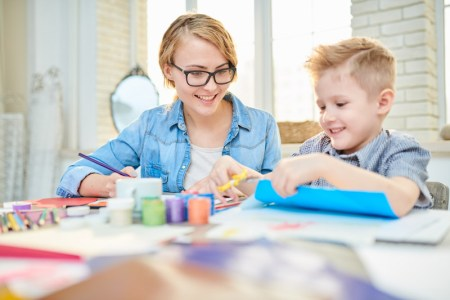 mother-and-son-crafting-together-at-home-LTK34BD.jpg