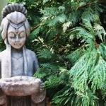 image: concrete garden statues anchor the landscape.