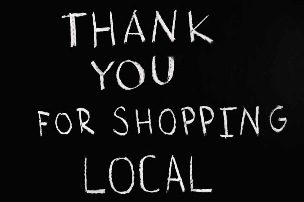 thank you for shopping local lettering text on black background for zero waste shop to help your sustainable new year resolutions
