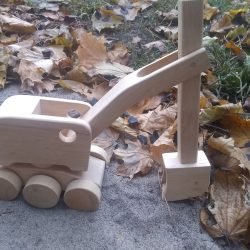 wooden toy steam shovel digging in sand