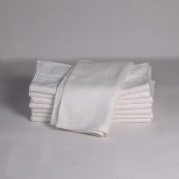 neatly piled stack of white bamboo towels