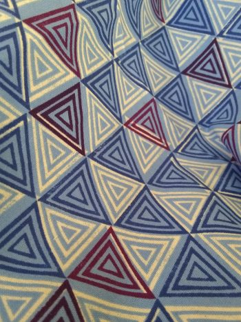 triangle patterned fabric in blues, white and purple
