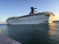 a cruise ship heading out to sea