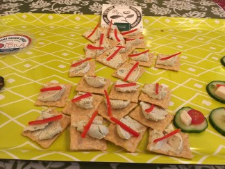 Scallion Treeline on Rice Crackers with red pepper