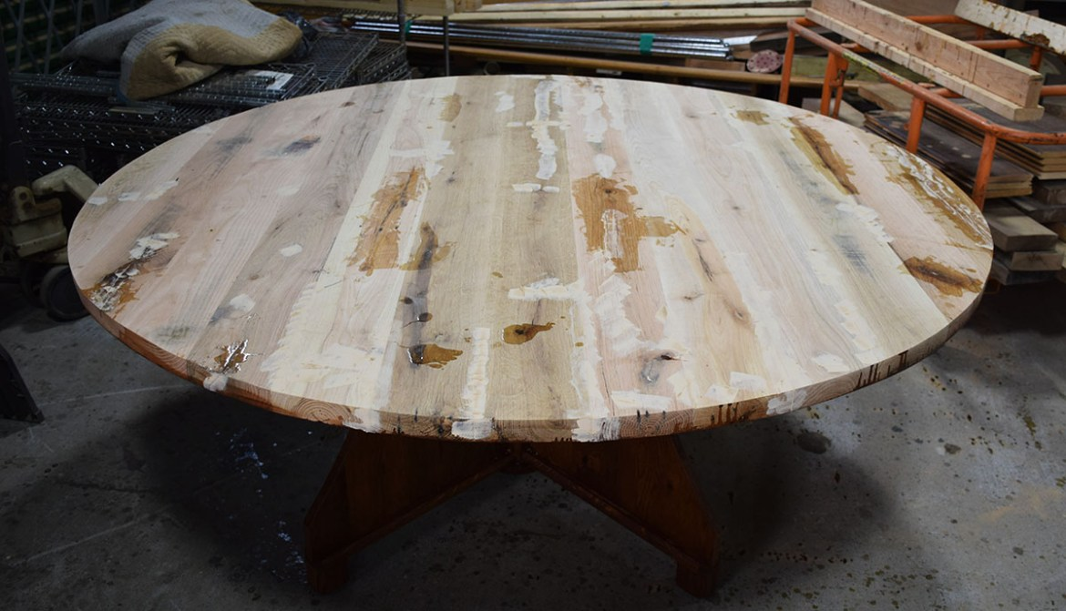 Unfinished table top with voids filled in and ready to sand.