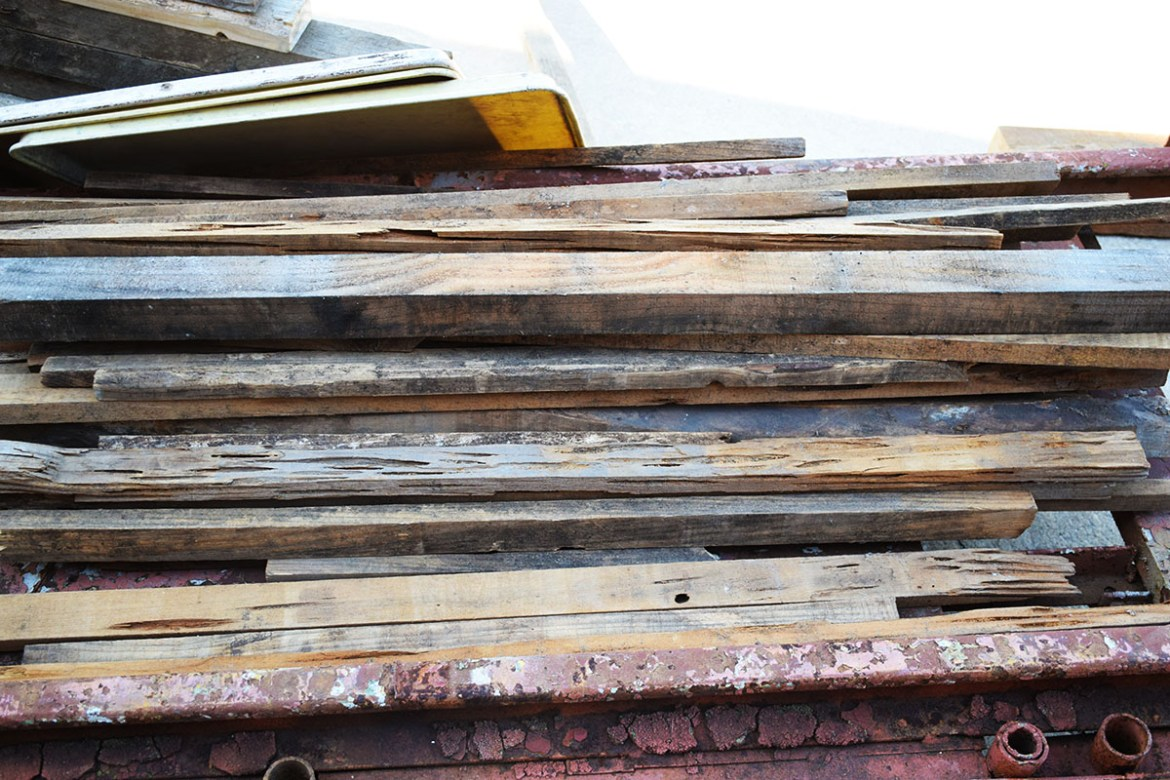 Sections of random scrap wood and pallet wood ready for the project!