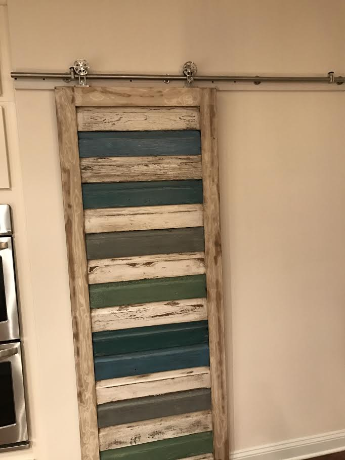 Finished Barn Door hanging in its new home.