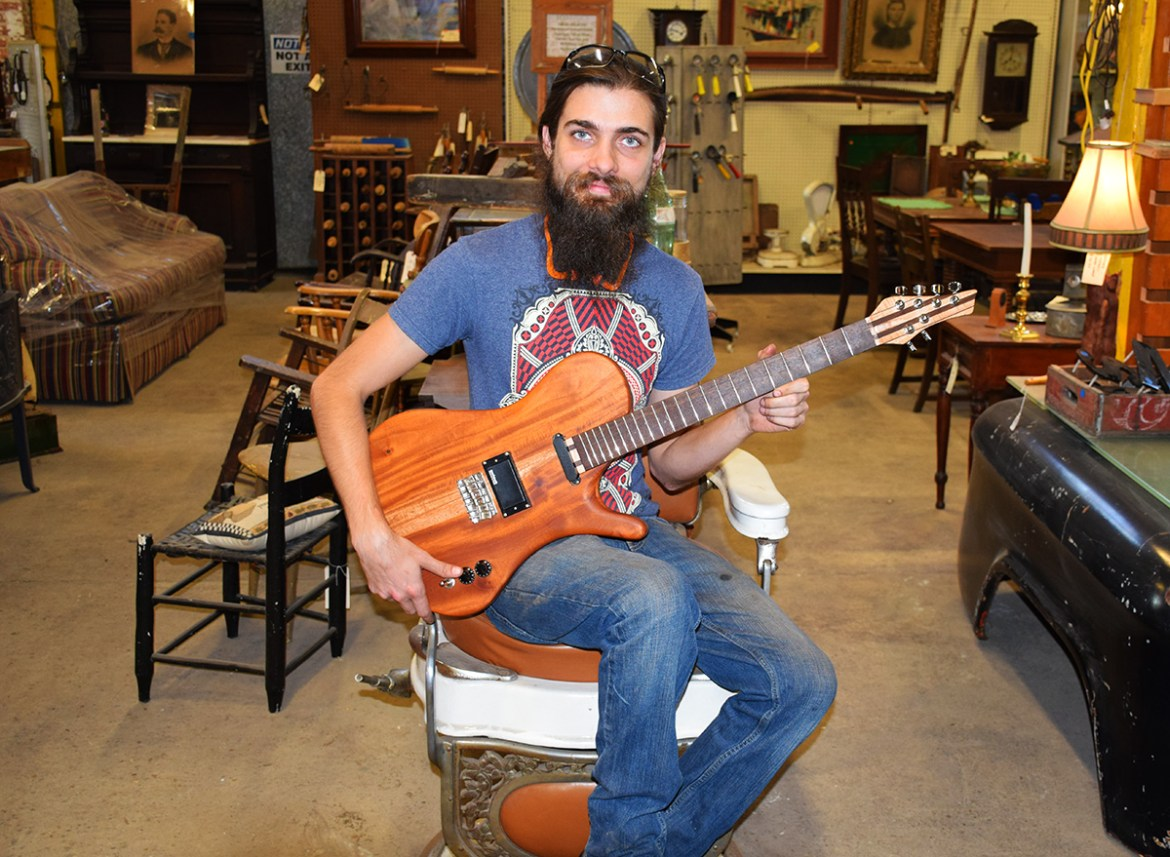Resident luthier Chris Lawson with his latest creation, The Eco Relicaster!